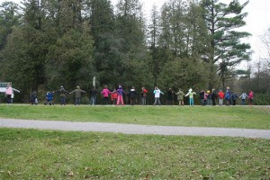 Students from a grade 4 class at Roger Neilson Public School form a line to demonstrate the width and location of a proposed bridge across Jackson Park.