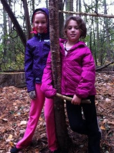 Isabel Hicks (left) and Megan Rivet make the acquaintance of a tree in Jackson Park