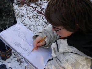 Student sketching in Edmison Heights Habitat Area - Drew Monkman